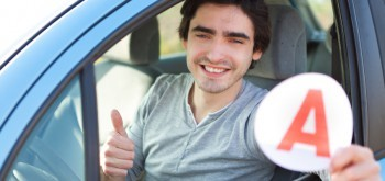 View of a young man happy to get his driving license