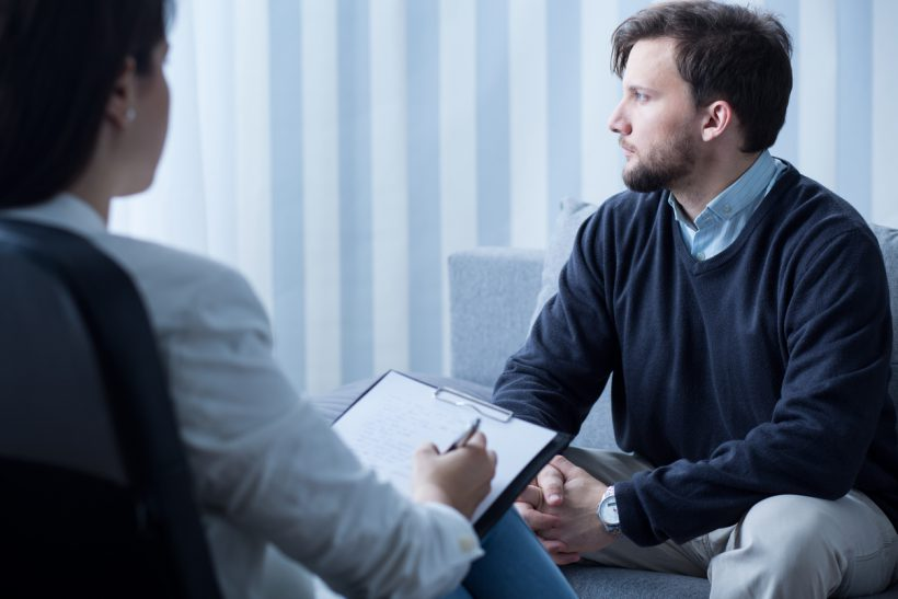 Young man during psychological therapy